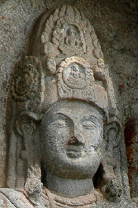 Four Buddhas in the crown of the Kushtaraja statue