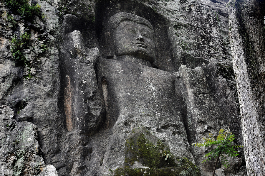 Rock-cut Buddha statue at the Dowa cave temple