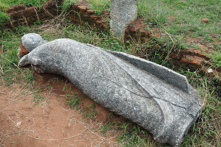 toppled Buddha statue in Thiriyai in northeastern Sri Lanka