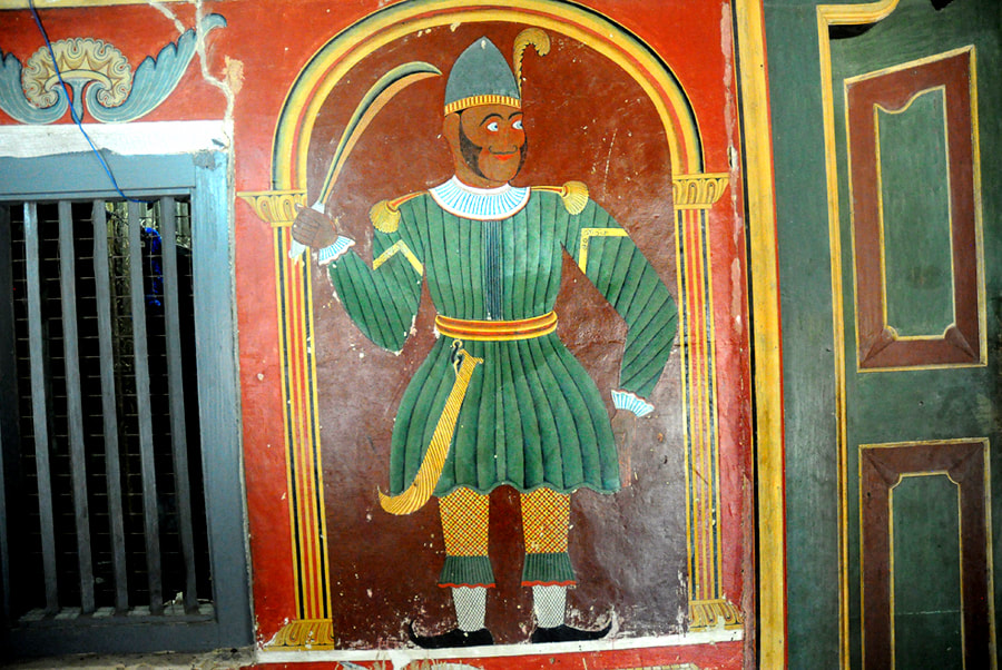 painted Portuguese soldier as Dvarapala