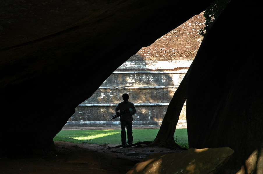 view through one of Mihintale's cave to the dome of Kantaka Chetiya