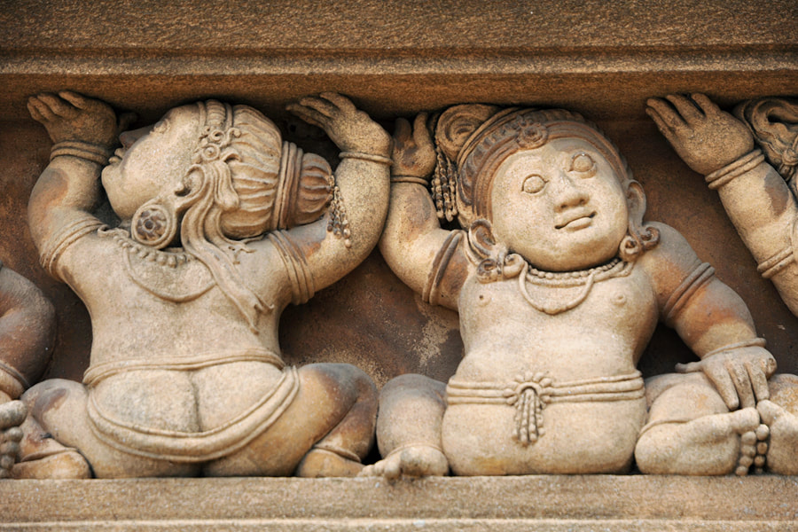 dwarf sculptures at the Kelaniya temple