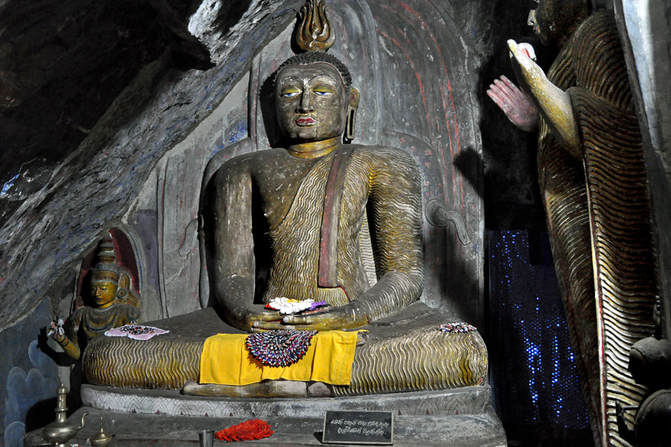 Sitting and standing Buddha in the rock chapel of Yapahuwa