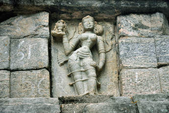female figure at the front of the ornate stairway of Yapahuwa