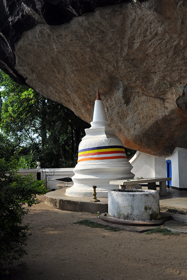 typical Sri Lankan stupa in a rock shelter at the Meda Maluwa