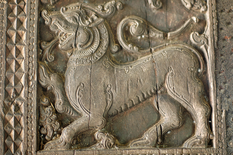 carving depicting a lion in the Embekke Temple in Sri Lanka