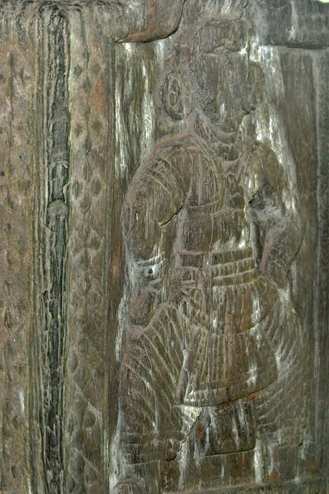 Panavitiya Ambalama woodcarving of a man dressed in the Kandyan style