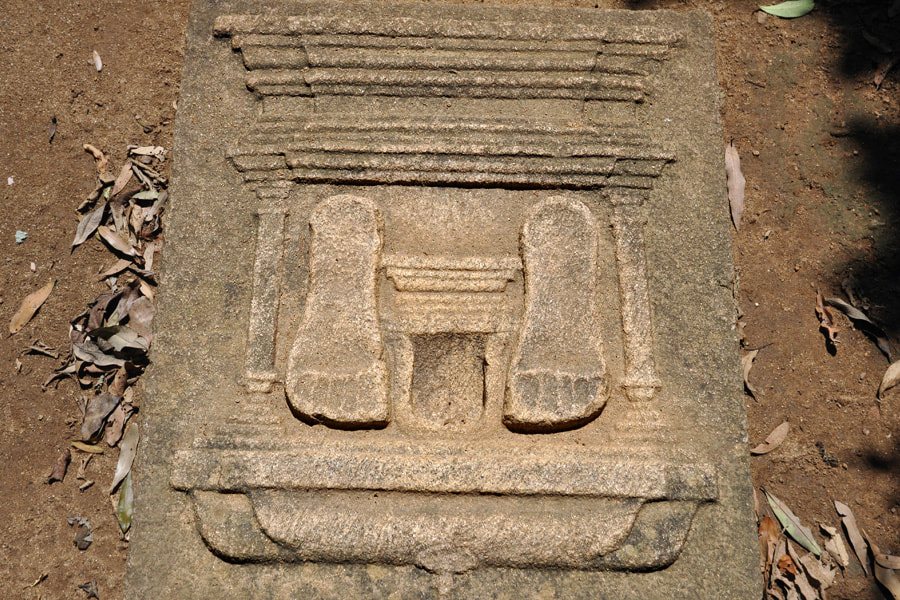decorated urinal stone in the ancient Sri Lankan monastery of Ritigala